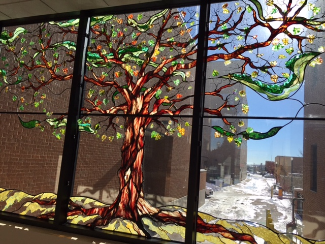 Stained glass tree in window