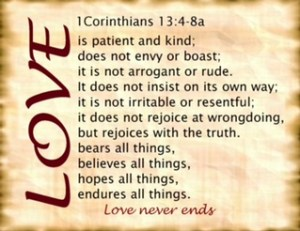 Love in rust font is slanted sideways on the left of parchment paper. First Corinthians 13:5-8a is printed on the paper.