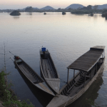 laos boats - Land Concessions in Laos & Cambodia