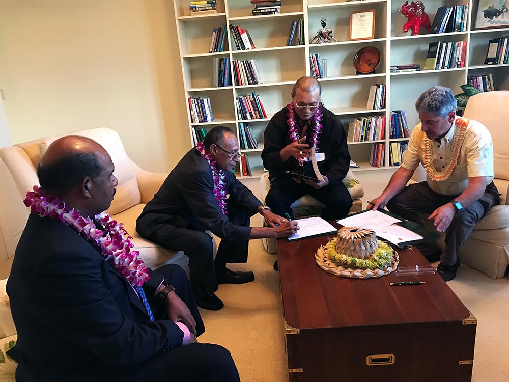 West Papua delegation signs mou with UHM President David Lassner