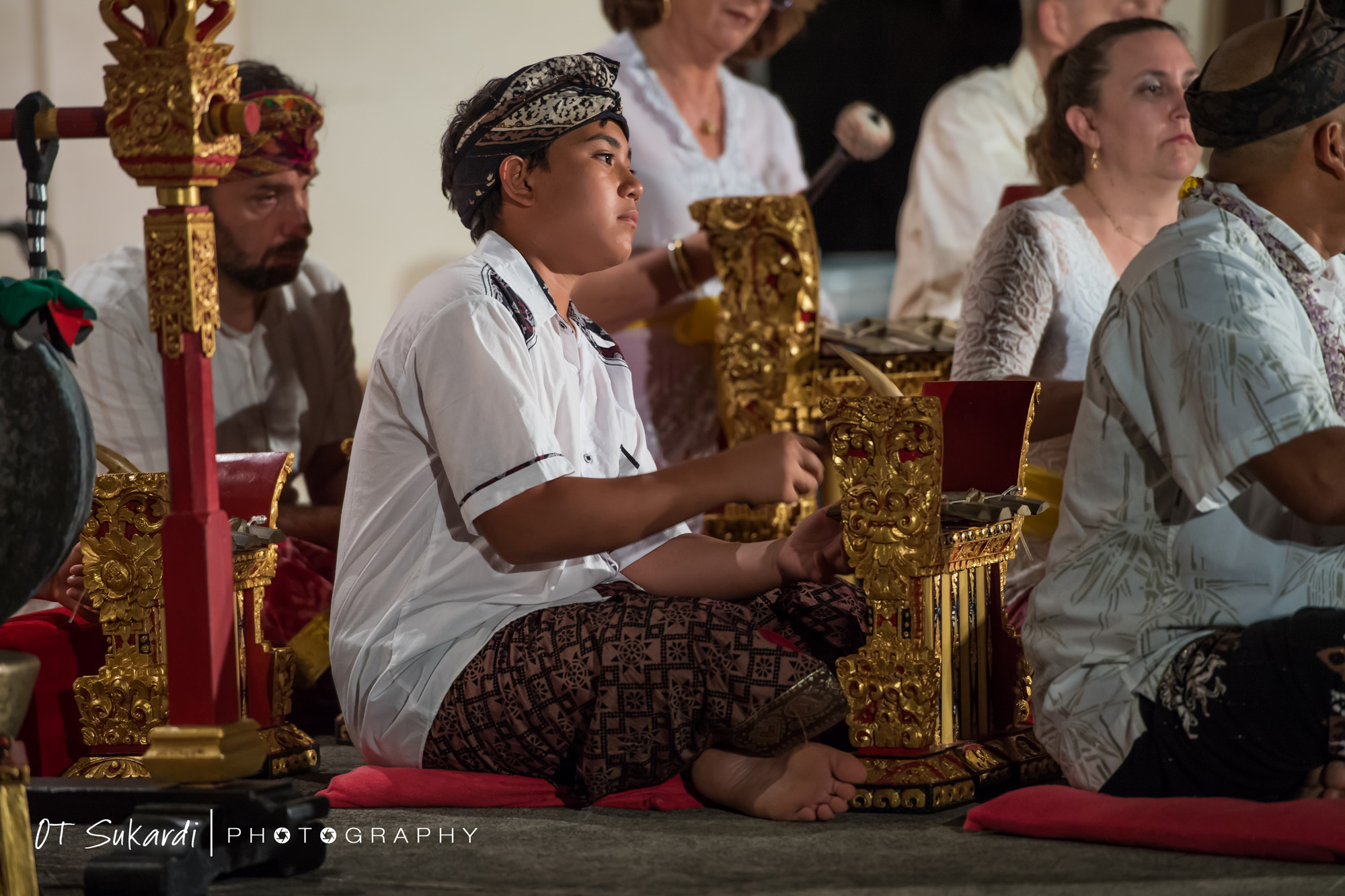 close up of boy playing gamelan piece