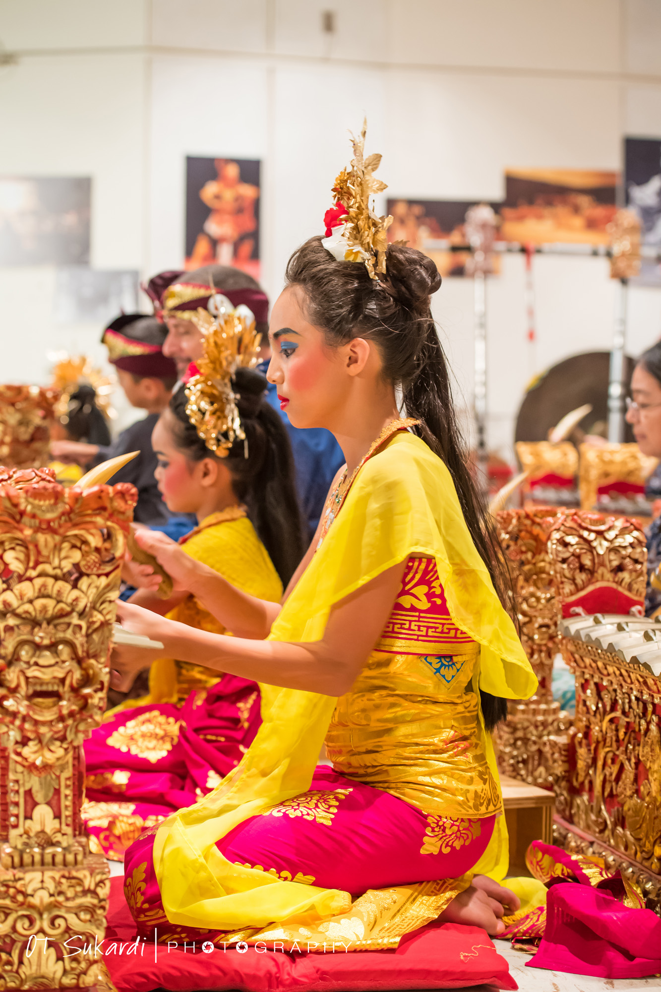 younger and older girl play gamelan
