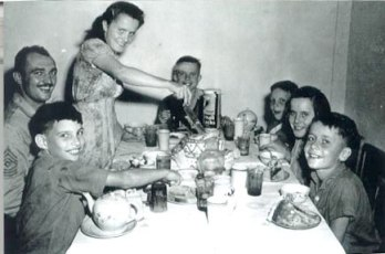 "Mary Previte and siblings ib September 10, 1945 eating a meal shortly after being flown from Weihsien - ""When the plane touched down in Sian, the men at the Office of Strategic Services (OSS) base served us ice cream and cake and showed us a Humphrey Bogart movie . I think it was ""Casablanca."" Kathleen and I slept that night in an officer's tent -- unaccompanied by bedbugs. The next night -- 9/11 -- we were home. We hadn't seen our parents for 5 1/2 years."" - courtesy of Weihsien-Paintings"
