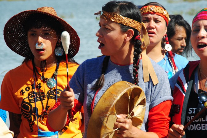 Activists singing alongside the Missouri River near Cannon Ball, ND - photo by C.S. Hagen