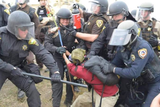 Activist woman being arrested - photo provided by Steve Gross
