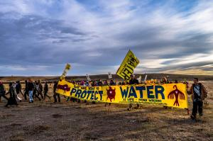 Activists on the plains marching Oct. 22 - photo by Rob Wilson Photography