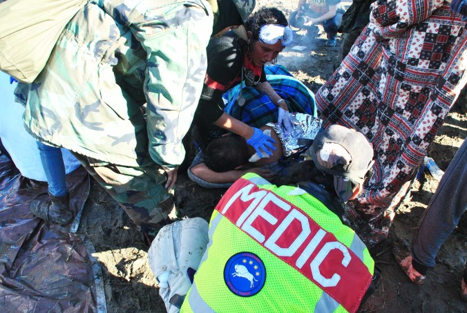 Medics battle hypothermia and hurry to warm activist - photo by C.S. Hagen