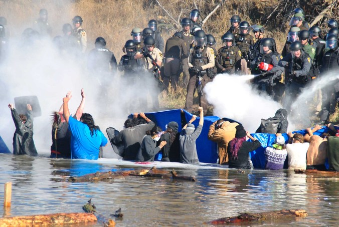 Police sprayed mace and pepper spray intermittently at activists in Cantapeta Creek - photo by C.S. Hagen