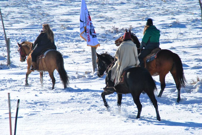 Horse riders in the snow outside Oceti Sakowin - photo by C.S. Hagen