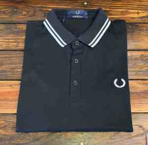 Fred Perry M102 Made in Japan Polo in black with white tipped collar folded view.