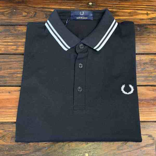 818b3b4c4 Fred Perry M102 Made in Japan Polo in black with white tipped collar folded  view.