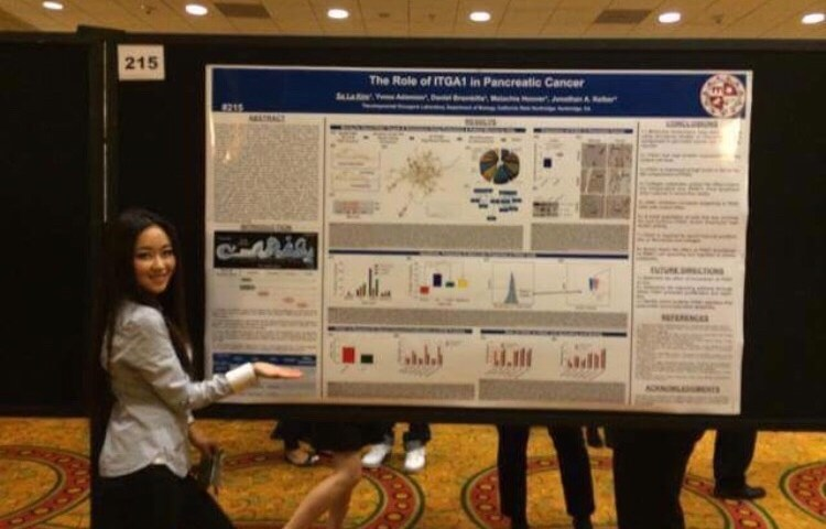 Sa La Kim, with an earlier poster presentation of her research