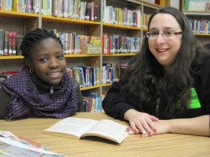 A Vassal Lane Upper School tutor meets with her student.