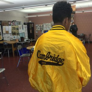 A current CRLS student models a vintage band jacket.