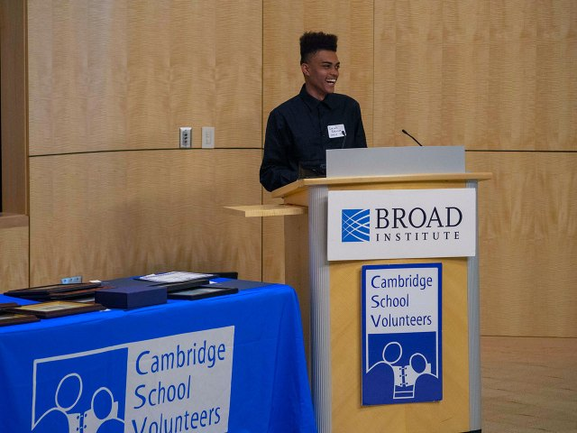 young man at podium marked Broad Institute