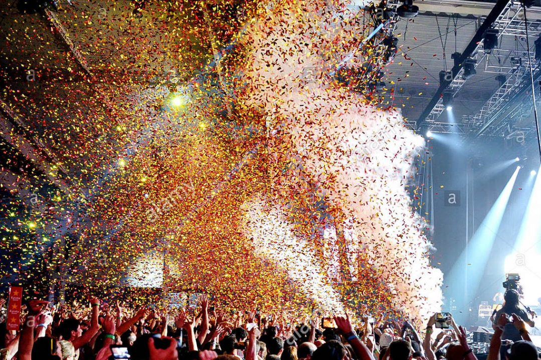barcelona-jun-19-crowd-in-a-concert-while-throwing-confetti-from-the-H6499D