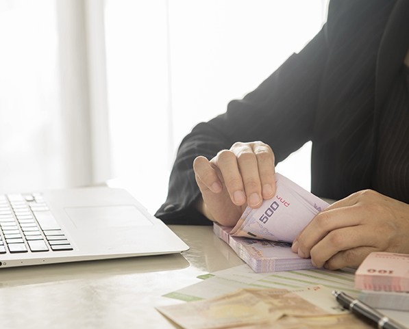 Bank employees are counting banknotes received or paid to customers.