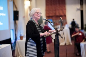 Betsy Julian accepts the 2018 Loving Award - standing at podium in front of audience.