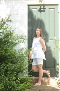 In the Sundial Garden at the American Clock and Watch Museum in Bristol, Conn., Taylor Plourd enjoys the sun. She is dressed in white garments, perfect for Saturday's White Night Bristol. The clothes were provided by Simply Vera Vera Wang and Princess Vera Wang, all available at Kohl's (Kohls.com). (Make up by Brittany Monico Martin of Forever Flawless Artistry.)