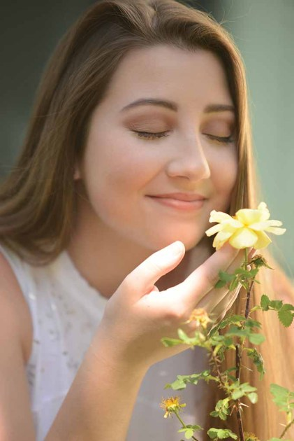 Taylor Plourde takes in the scent of a rose growing in the Sundial Garden at the American Clock and Watch Museum. The museum is hosting White Night Bristol on Saturday. (Makeup by Brittany Monico Martin of Forever Flawless Artistry.)