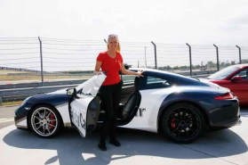 LEIPZIG, GERMANY - JULY 11: Driver Instructor Michelle Gatting in front of a Porsche 911 Carrera S Safty car at the 'Porsche Experience For Women' Event on July 11, 2016 in Leipzig, Germany. (Photo by Isa Foltin/Getty Images for Porsche AG & Porsche Design)