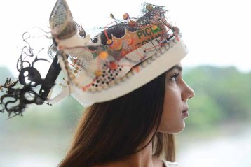 Julissa Ragunauth wears a hat created by artist Daniel Lanzilotta.