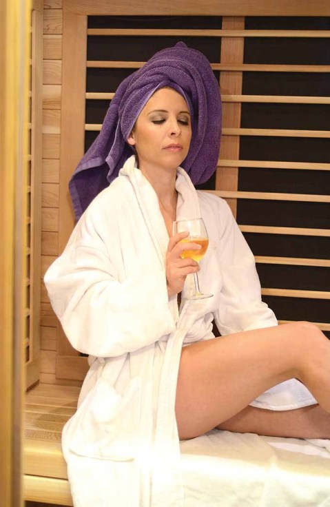 Lori-Ann Marchese kicks back with a glass of champagne at Pure Skin in Southington, Conn. after enjoying a facial and some massage therapy.