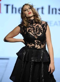 LOS ANGELES, CA - OCTOBER 12: A model walks the runway wearing Morgan Strickland at Art Hearts Fashion Los Angeles Fashion The Art Institutes Showcase on October 12, 2016 in Los Angeles, California. (Photo by Arun Nevader/Getty Images for Art Hearts Fashion)