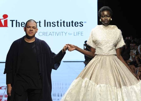 LOS ANGELES, CA - OCTOBER 12: Fashion designer Patrick Kevin Francisco (L) walks the runway with a model at Art Hearts Fashion Los Angeles Fashion The Art Institutes Showcase on October 12, 2016 in Los Angeles, California. (Photo by Arun Nevader/Getty Images for Art Hearts Fashion)