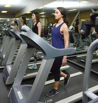 Miss Bristol Gina Salvatore, in front, and Miss Forestville Erika Farrell get fit on the treadmills at JM Fitness.