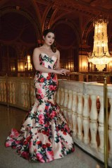 Taylor Plourd stands in the lobby of The Palace Theatre in Waterbury wearing a prom gown from Sherri Hill, provided by Dazzle Boutique of Waterbury.