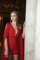 Savannah Voigt's prom look, with the red romper, is an interesting twist on the traditional look for the high school rite of passage. Voight, of Thomaston, was photographed in The Palace Theater in Waterbury.