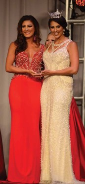 Alyssa Anderson, Miss Wolcott, left, accepts her preliminary award for Lifestyle and Fitness from Miss Connecticut.