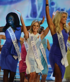 Miss Connecticut Eliza Kanner waves to the crowd during introductions at the first night of Miss America pageant preliminary competitions.