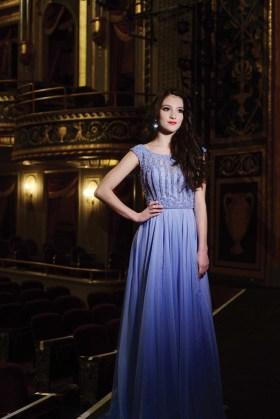 Lindiana Frangu wears a dress from Sherri Hill.