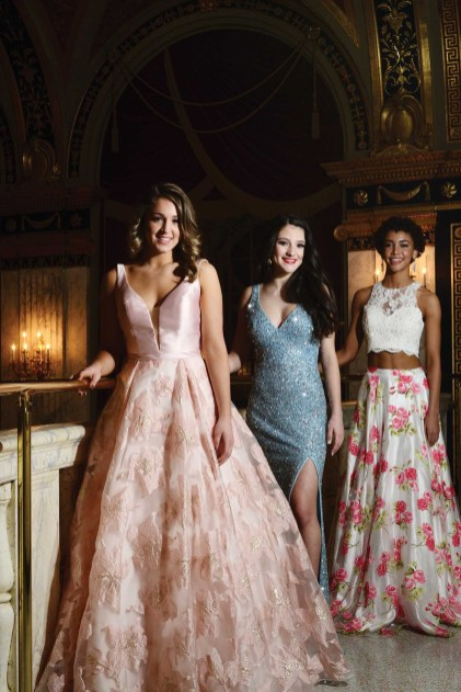 Morgan Mancini, left, Lindiana Frangu, and Kaliegh Garris in gowns provided by Dazzle Boutique in Oxford, Conn.