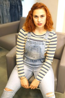 Victoria wears a blouse from derek heart and overalls from Blue Spree.