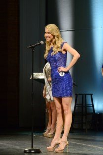 Acacia Courtney introduces herself at the Miss Connecticut USA pageant wearing the opening number blue.