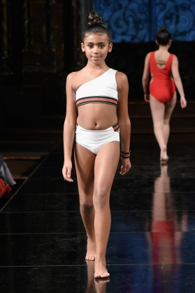 NEW YORK, NY - FEBRUARY 09: A model walks the runway at KK SWIMWEAR At New York Fashion Week Powered By Art Hearts Fashion NYFW at The Angel Orensanz Foundation on February 9, 2019 in New York City. (Photo by Meera Fox/Getty Images)
