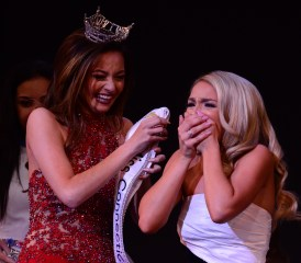 Bridget Oei, left, drapes the sash over the new Miss Connecticut Jillian Duffy.