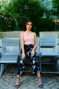 Model Iraima Lopez wears a New Day top in smoked pink and New Day floral pants in black and white, both from Target (Target.com).