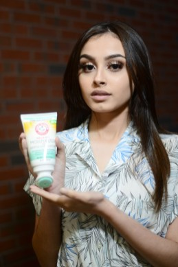 Model Iraima Lopez holds a tube of Arm & Hammer's Foot Care Moisturizer and Gentle Exfoliators. (MIKE CHAIKEN)