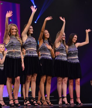 Payton May, far right, wears a Tony Bowls dress at Miss America's Outstanding Teen in Orlando July 27.