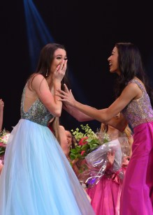 Payton May, left, is congratulated by Katelyn Cai after May learned she is the new Miss America's Outstanding Teen.