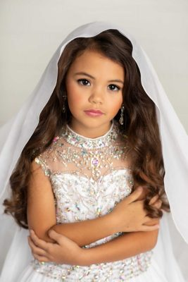 Bella Kate Batton wears a gown from Little Rosie.