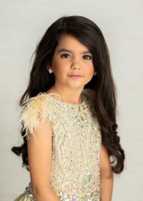 Lola Faye Batton wears a Gown from Little Rosie.