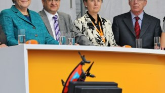 Chancellor Angela Merkel looks at a camera drone