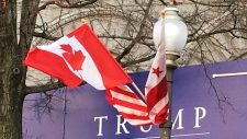 Canadian and American flags fly in Washington