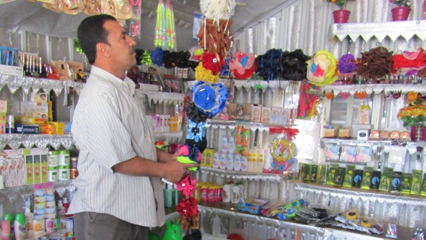 Faisal surveying his accessory shop.