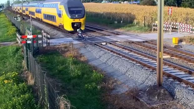 Close Call Between Passenger Train Dutch Cyclist Caught On Camera Ctv News